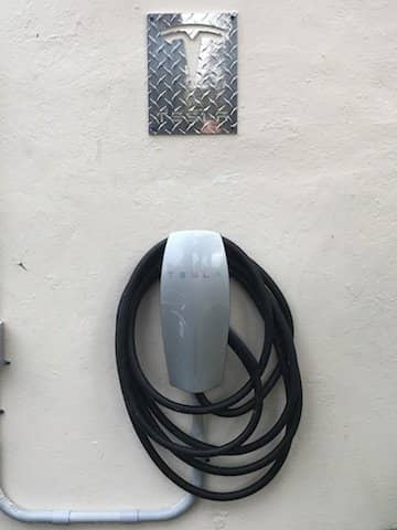 Aluminum Diamond Plate Tesla Sign on Wall