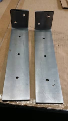 Custom fabricated metal angle with holes