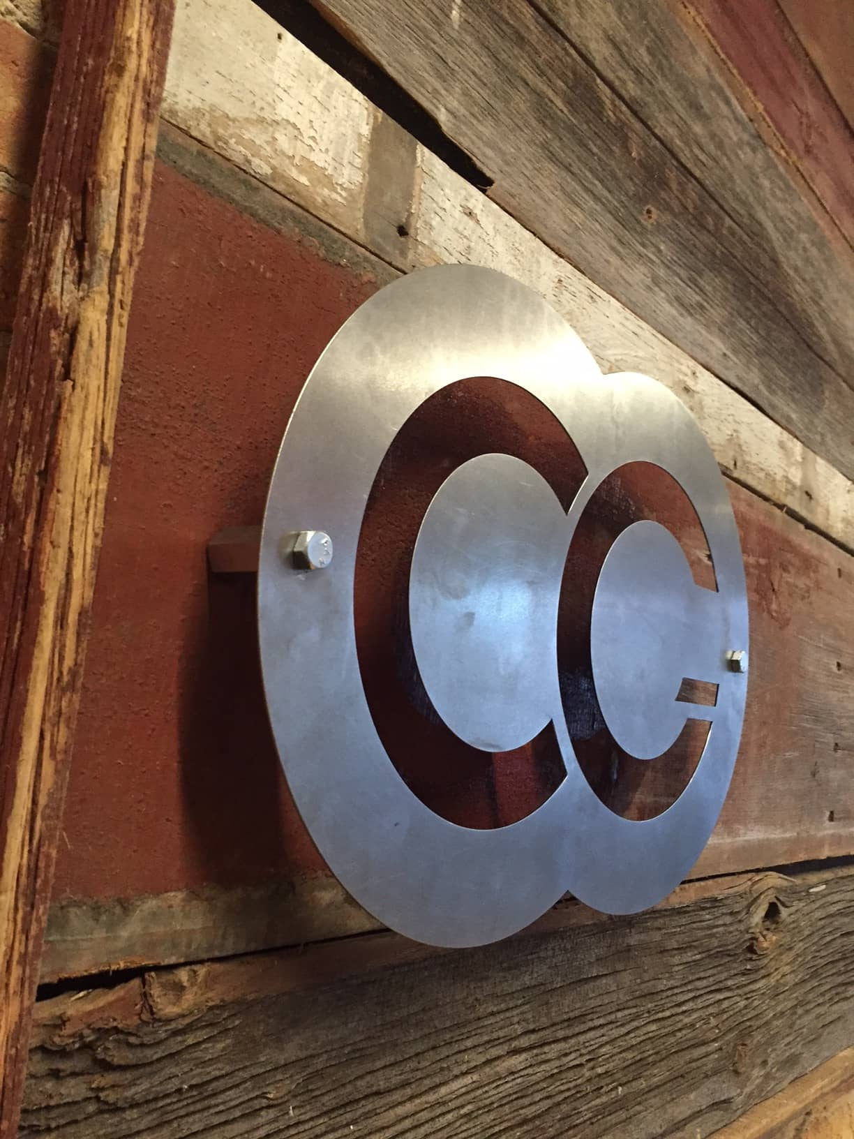 Company Logo, Carbon Steel, mounted to the wall
